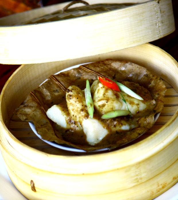 Steamed fish in lotus leaf with malabar curry spices