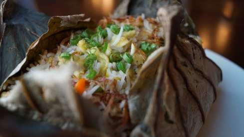 Vietnamese fried rice chicken and shrimps wrapper in lotus leaf at Mekong