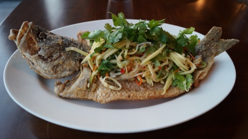 Spicy fish with green mango salad and seafood dressing