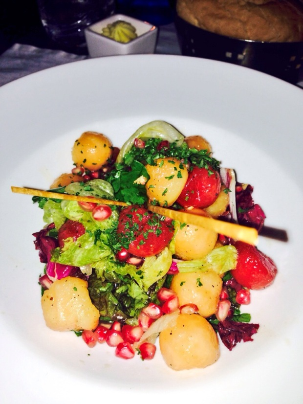 salad of melon, pomegranate and spinach in honey mustard dressing.