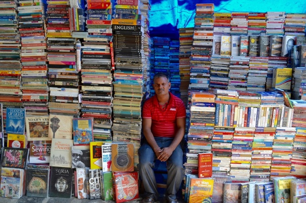low res Dinesh Mondol at his booth on Book Street