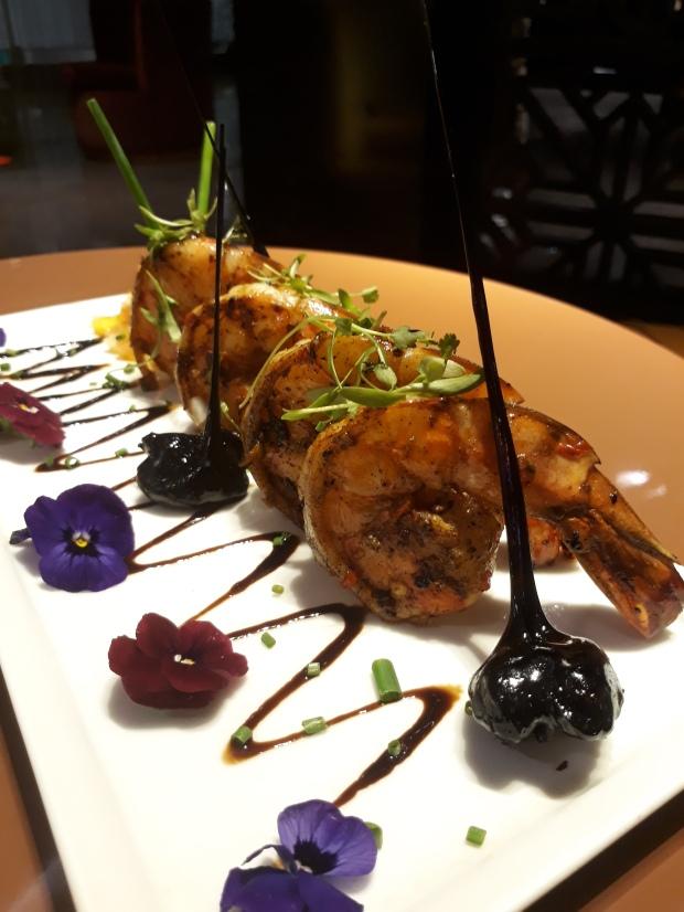 Grilled tiger prawns with caramalised walnuts and micro greens at Jeon at Hotel Sea Princess