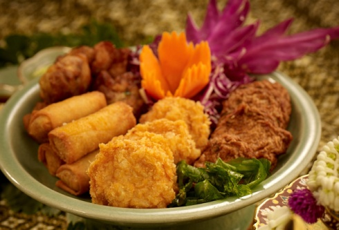 Fish cakes with spring rolls